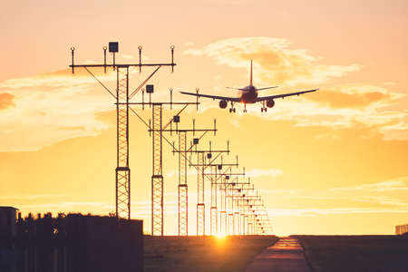Airplane landing on the airport runway at the sunset. Prague, Czech Republic Standard-Bild