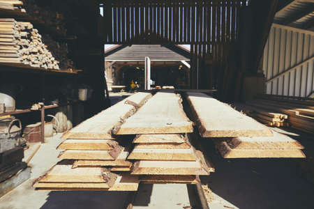 Lumber industry. Stack of timber at the sawmill.