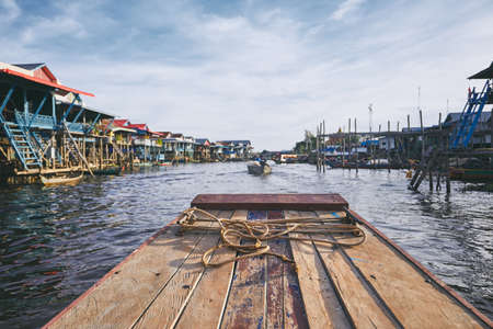 Boat in the middle of the floating village on Tonle Sap Lake. Siem Reap Province, Cambodia.