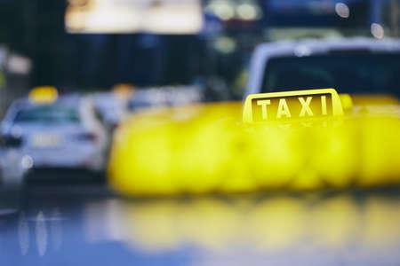 Lighting taxi sign. Cars against city street at night. Prague, Czech Republic. Stok Fotoğraf