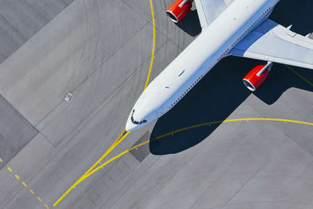 Aerial view of airport. Airplane taxiing to runway before take off. Stock Photo