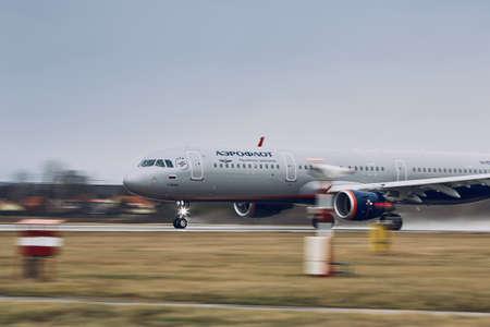 Prague, Czech Republic - December 11, 2018: Aeroflot Airbus A321 during take off in rain at Prague Airport on December 11, 2018. Редакционное