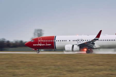 Prague, Czech Republic - December 11, 2018: Norwegian Boeing 737-800 during landing in rain at Prague Airport on December 11, 2018.