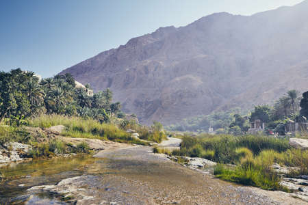 Landscape of Oman. Road in the middle of Wadi Tiwi in idyllic day. 写真素材