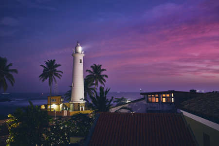 Lighthouse in fort in Galle. Old town in Sri Lanka at sunset.
