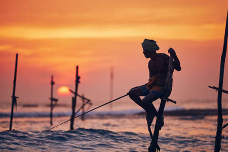 Silhouette of the traditional fisherman. Traditional stilt fishing near Galle in Sri Lanka.