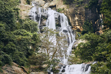Waterfall in the middle of pure nature. Ravana Falls near town Ella is popular sightseeing attraction in Sri Lanka. Stock Photo