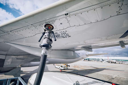 Preparations before flight. Refueling of airplane at airport. Travel and industry concepts. Imagens