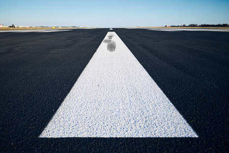 Surface level of airport runway with road marking against clear sky. Reklamní fotografie