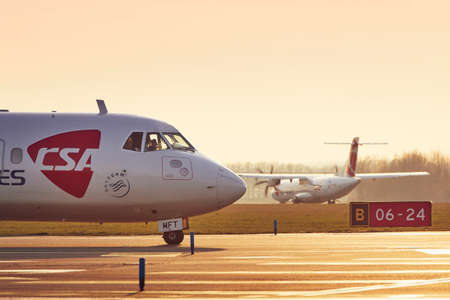 Prague, Czech Republic - March 29, 2019: Two turboprop airplanes ATR-72 of Czech Airlines (CSA) before take off from Vaclav Havel Airport Prague on March 29, 2019. Editorial
