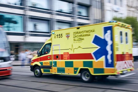 Prague, Czech Republic - April 9, 2019:  Ambulance car of Emergency medical service rushing on the street at Wenceslas Square in Prague on April 9, 2019. Editorial