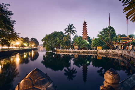 Scenic view of West lake and water reflection of Tran Quoc Pagoda - the oldest Buddhist temple in Hanoi, Vietnam. Stock Photo