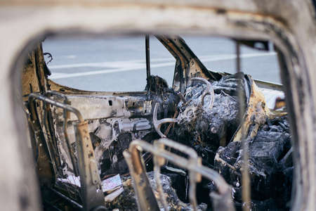 Problem on road. Car after accident with fire. Close-up of burnt vehicle steering wheel. Фото со стока - 128482371