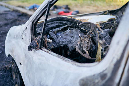 Problem on road. Car after accident with fire. Close-up of burnt vehicle steering wheel.