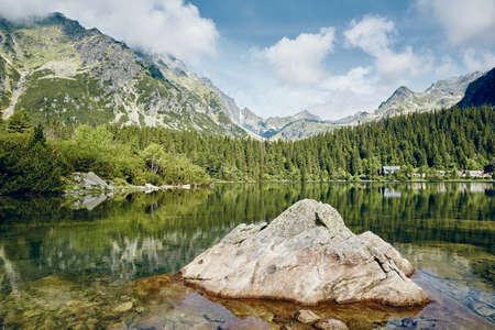 Beautiful lake against rocky mountains. Popradske pleso in High Tatras, Slovakia.