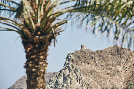 Old fort on costal mountains in Muscat, Sultanate of Oman. Banco de Imagens