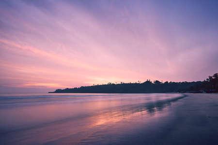 Empty sand beach against coast at amazing sunrise. Tangalle, Sri Lanka. Banco de Imagens