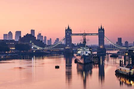 Skyline of London. Tower Bridge against cityscape with skyscrapes at dawn. Stock Photo - 129897036