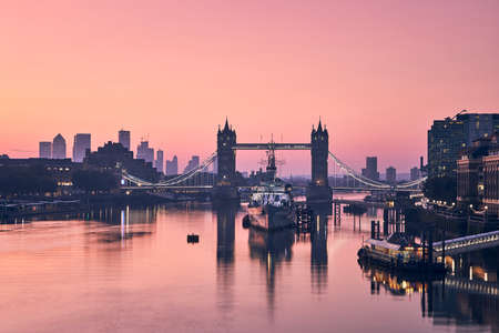 Tower Bridge against cityscape with skyscrapes at sunrise. Skyline of London, United Kingdom. 写真素材