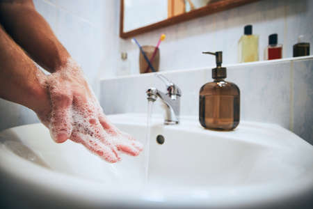 Washing hands at home in bathroom. Healthy lifestyle, hygiene and prevention viral and bacterial diseases.