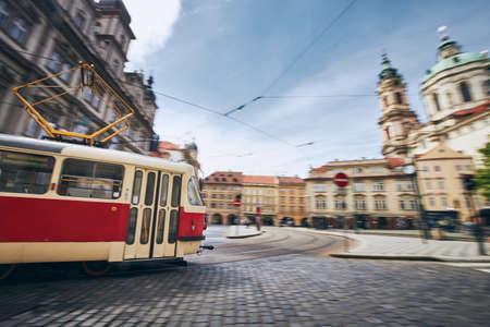 Daily life in city. Tram of public transportation in blurred motion. Prague, Czech Republic.