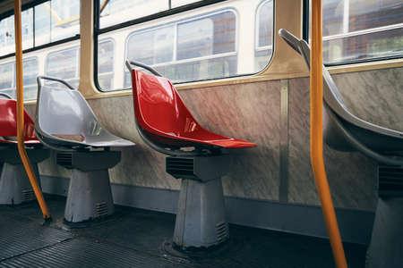 Empty seats in old tram of public transportation.