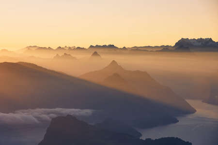 Scenic view of lake and mountains against moody sky during beautiful sunrise. Lucerne, Switzerland. Stockfoto