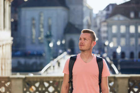 Portrait of young tourist. Young man walking at street of old town. Zurich, Switzerland. Stockfoto