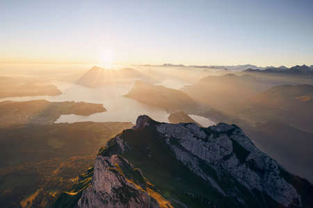 Scenic view of lake and mountains against beautiful sunrise. Lucerne, Switzerland.