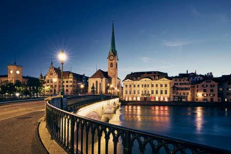 Illuminated Zurich cityscape with Fraumunster Church at twilight, Switzerland Stock fotó