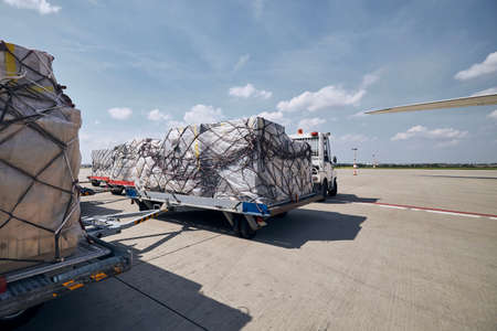 Cargo containers at airport. Preparation before for loading to freight airplane.