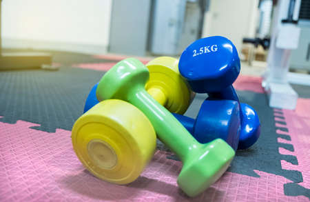 Dumbbell multi-color and multi-size In the gym Stock Photo