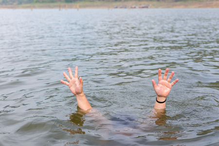 hand of drowning man asking for help