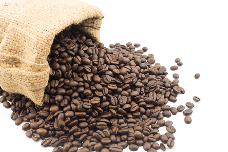 heap: coffee beans in bag isolated on white background