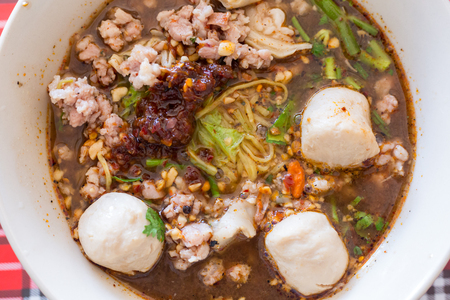 Spicy TOM YAM pork noodle soup with lemongrass, chilly pasted and lime juice Stock Photo