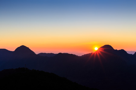 Sun rise with blue and orange sky in the morning 免版税图像