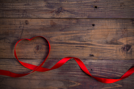 lentines day celebration concept background. Red ribbon hearths