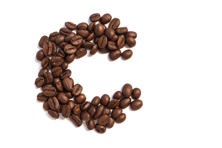 C from coffee beansisolated on a white background