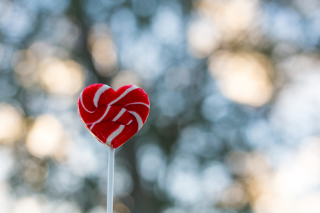 Valentines Day Heart candy Bokeh nature Background Stock Photo