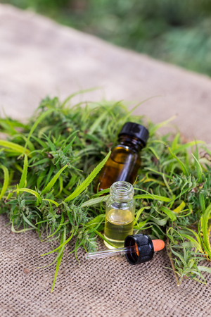 Medicinal cannabis with extract oil in a bottle Stock Photo