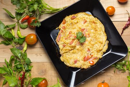 omelet in a plate. Reklamní fotografie