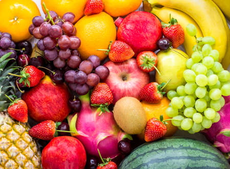 Fresh fruits.Assorted fruits colorful,clean eating,Fruit background Imagens