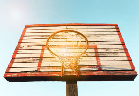 Wooden street basketball board with sunny sky. Vintage tone filter effect color style. Stockfoto