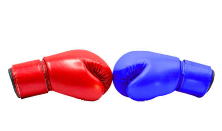 Boxing gloves Red and Blue hitting together isolated on white background