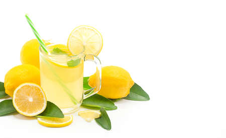Lemon juice in a glass isolated on a white background with copy space,Lemon sliced with leaves. Stok Fotoğraf