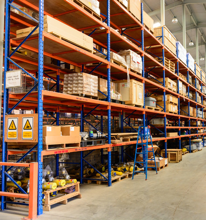 Rows of shelves with boxes and modern warehouse