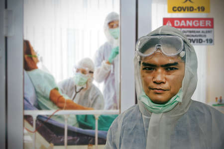 Work of the medical team and portrait male doctors are tired and masked scars work to take care of female influenza patients, the coronavirus, covid-19 at the detention center of the hospital. Stock Photo