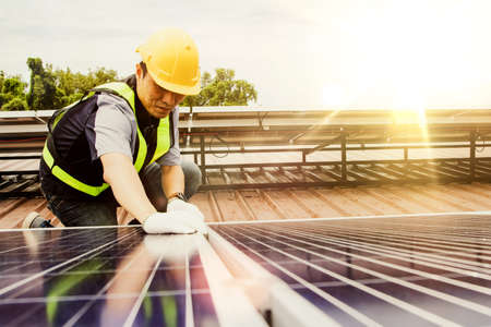 Solar panel installation work concept : Asian Architects Electrical engineers inspect the work of installing large solar panels to produce and sell electricity for industrial work : Selective focus