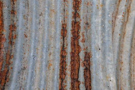 corrugated iron: A rusty corrugated iron metal texture.