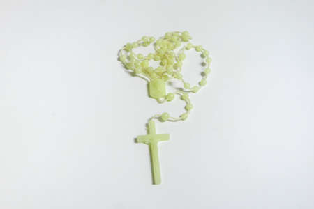 green rosary with isolated background Stock Photo